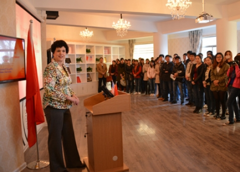 Linda Serra Hagedorn delivers a speech at the grand opening of the American cultural center at Henan Normal University in China. Photo contributed by Hagedorn.