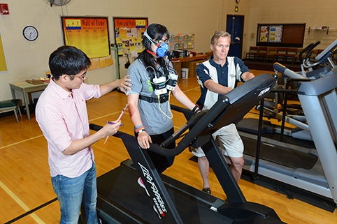 The work continues. Gregory Welk (right) and doctoral students Youngwon Kim (left) and Yang Bai (center) are now testing the accuracy of the latest fitness bands on the market. Photo by Bob Elbert