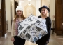 Iowa State apparel students Chelsea Blake (left) and Josie Saunders (right) developed a fashion-themed umbrella for the Textiles and Clothing Museum's Mary Alice Gallery in Morrill Hall. Photo by Ryan Riley.