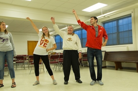 Betty Wright dances with Iowa State students as part of a Music and Movement outreach program for people with Parkinson's disease. Photo by Ryan Riley.