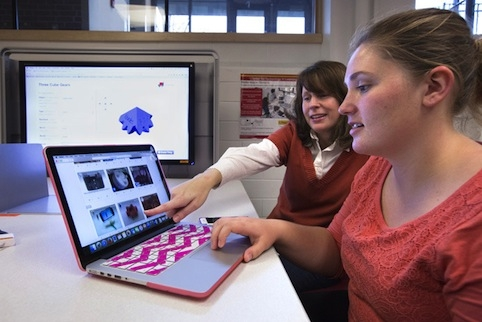 Junior Nettie Payne, right, and Larysa Nadolny, assistant professor in the School of Education, review a project for Curriculum and Instruction 202, a course Nadolny redesigned using game-based learning. Photo by Christopher Gannon.