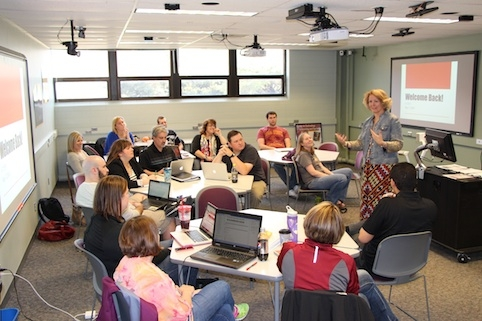 Denise Schmidt Crawford, an associate professor in the School of Education, welcomes online master's students in education during a campus visit. Contributed photo.
