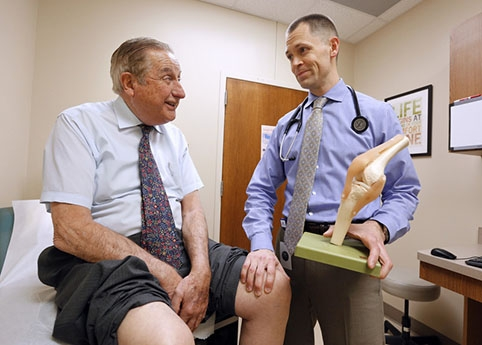 Shawn Spooner, an Urbandale doctor and veteran of the U.S. Navy, credits much of his success to his training in kinesiology at Iowa State University. Photo by Christopher Gannon.
